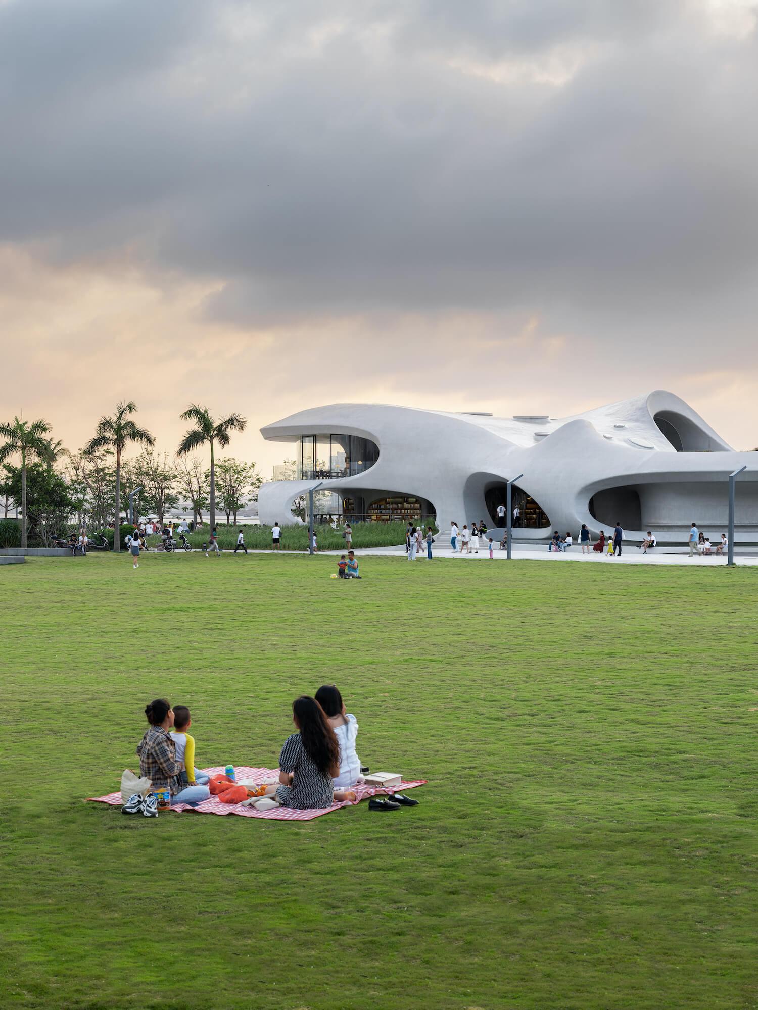 people sitting in public landscape